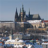 Lesser Town (Mala Strana) covered by snow with Prague Castle and St. Vitus Cathedral above